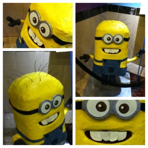 Paper Mache Minion character in movie theater lobby